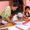 Paulina Conde and Matsiguenka girls in the Matsiguenka School in Boca Manu, Peru. © Daniel Rosengren