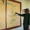 A Moru rhino ranger showing a map of the Moru area. Moru, Serengeti, Tanzania. © Daniel Rosengren