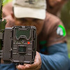 PAC rangers Francisco Gomes, Jessica George, Octavious Hendricks and FZS project manager Thadaigh Baggallay changing memory cards of a camera trap in Kanuku Mountains Protected Area, Guyana. © Daniel Rosengren