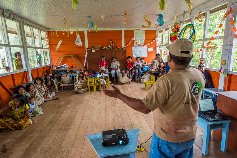 "Eustaquio Cahuaniri translating at a CARE meeting with the Matsiguenka community about the ""Plan de Vida"" (Plan of Life). Yomibato, Manu NP, Peru. © Daniel Rosengren"