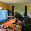 Rian Labuschagne (FZS Serengeti Programme Manager, left), Gerald Ernest Nyaffi (Radio and IT Technician at FZS, middle) and Ramadhani Bakari Hamisi (TANAPA, Park Warden for the Control Room and soon to be Pilot) in the Control Room building. From here rhinos will be monitored, rangers directed and potentially tourism cars monitored for off-roading and speeding etc. Seronera, Serengeti, Tanzania. © Daniel Rosengren