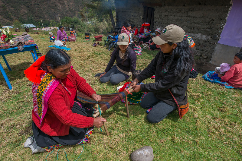 A woman weaving scarfs out of alpaca wool. She is a part of the Asociacion de Madres Tejedores, a project teaches women to weave and that way help them be able to support themselves and make a living by also teaching the to run a business. Patanmarca, Peru. © Daniel Rosengren