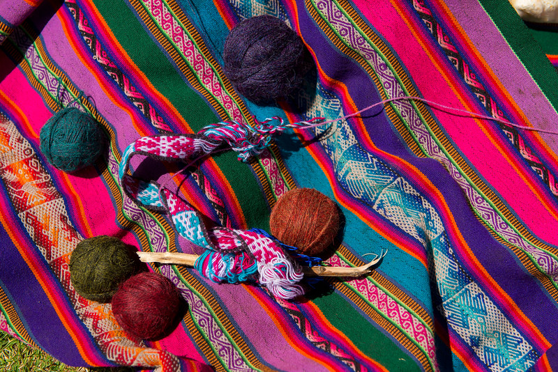 Alpaca wool and a scarf made by wommen in the Asociacion de Madres Tejedores, a project teaches women to weave and that way help them be able to support themselves and make a living by also teaching the to run a business. Patanmarca, Peru. © Daniel Rosengren