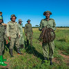 Members of the desnaring team and a TANAPA ranger (with the gun) with collected snares. Grumeti GR, Tanzania. © Daniel Rosengren