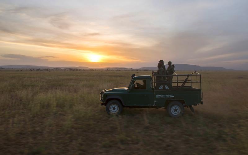 TANAPA's rhino rangers driving in the serengeti. Tanzania. © Daniel Rosengren