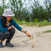 Esperanza Leal showing a stick marking the nest with eggs of the Arrau Turtles. Photographed along the river Caquetá, Colombia. Protecting these turtles and their eggs is one of the projects FZS run in the area. © Daniel Rosengren / FZS