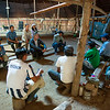 The FZS and Colombia Parks ranger team during in one of many meetings with local villagers in a Maloka (large community hut) along the River Caquetá, Colombia. © Daniel Rosengren / FZS