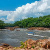 The FZS and park ranger team travelling in a boat down the Rio Mesay in Chiribiquete NP, Colombia. Here most of the team have gone off the boat so the driver can make a difficult passage with as little weight as possible. Chiribiquete National Park, Colombia. © Daniel Rosengren / FZS