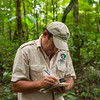 Project leader Thadaig Bagallay notes and GPS points in the Kanuku Mountains Protected Area, Guyana. © Daniel Rosengren / FZS
