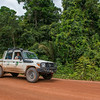 Project leader Thadaig Bagallay driving in the rainforest between Lethem and Georgetown. This road is from time to time rather bumpy, making it a full day drive, Guyana. © Daniel Rosengren / FZS