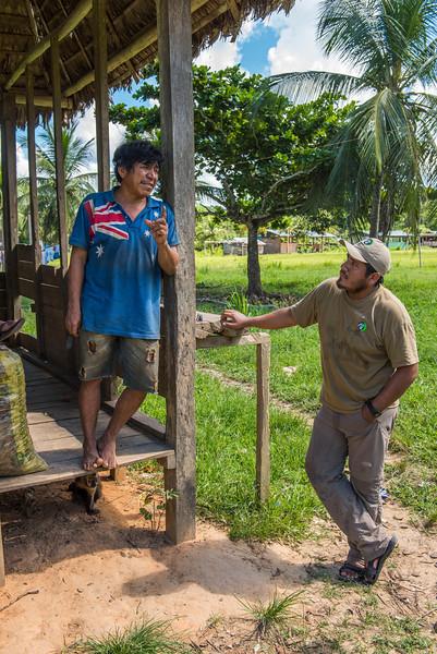 Kevin Ibañes (right) talking to a local villager in Sonene, Peru. © Daniel Rosengren / FZS