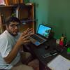 Kevin Ibañez at his desk in the FZS office in Puerto Maldonado, Peru. © Daniel Rosengren / FZS