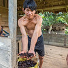 Villager with a bag full of Brazil nuts. Local villagers are allowed to enter the Tambopata NR and Bahuaja Sonene NP to collect these nuts as a way of sustainably benefitting from these protected areas. Sonene, Peru © Daniel Rosengren / FZS