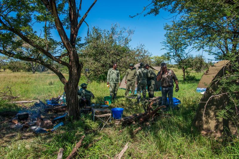 The FZS de-snaring team having lunch at camp. Grumeti GR, Tanzania. © Daniel Rosengren
