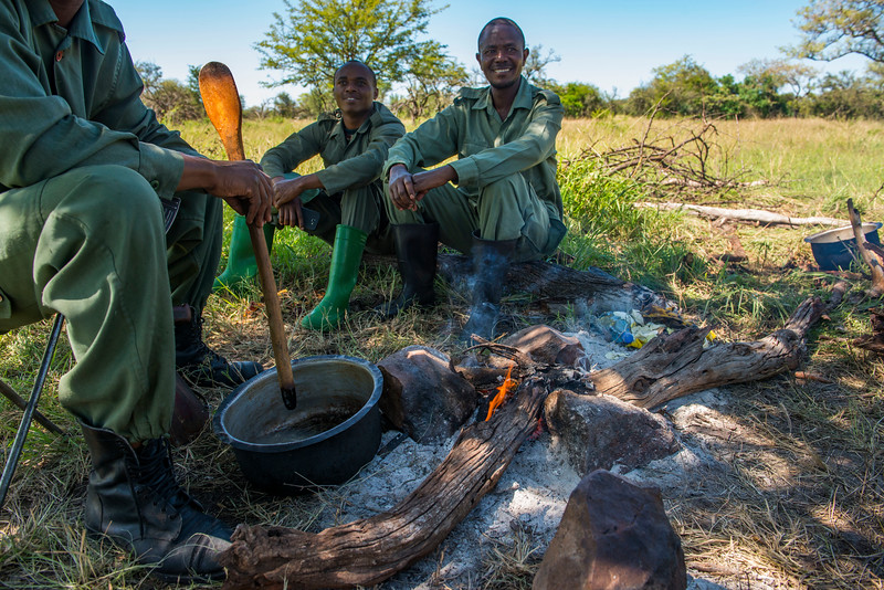 The FZS de-snaring team having lunch at camp. Grumeti GR, Tanzania. © Daniel Rosengren