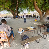 FZS having a meeting with a local community under two large Mango trees. Nabwalya area, Zambia. © Daniel Rosengren