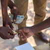 A COCOBA annual cash payout meeting in Katibunga, Zambia. COCOBA (Community Conservation Bank) is a micro finance system taught by FZS where small local groups invest money in the bank. They can also borrow money with interest for startup or equipment investments in eco-friendly businesses. Each year, investors in the bank get a share related to their investment out of the profit of the bank. © Daniel Rosengren