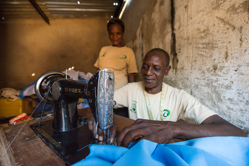 A man from a COCOBA group in Katibunga, Zambia. COCOBA enabled him to borrow money to start up a very successful tailoring business and he is very thankful for COCOBA to give him this chance to change his life. © Daniel Rosengren
