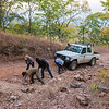 A FZS car on its way up the escarpment from Nabwalya, Zambia. After struggling to get up the slope the team had to get out and even out the road by adding and removing rocks. © Daniel Rosengren
