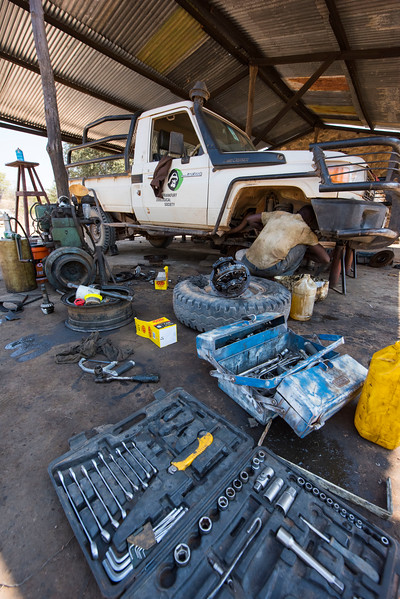 A mechanic fixing a car at the FZS garage in North Luangwa, Zambia. © Daniel Rosengren