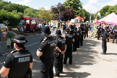 People protest against Fracking in Balcombe over worries of water pollution caused by Caurdrilla drilling operation. The Police Line