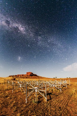 """Tile 107, or """"the Outlier"""" as it is known, is one of 256 tiles of the MWA located 1.5km from the core of the telescope. Lighting the tile and the ancient landscape is the Moon. Credit: Pete Wheeler, ICRAR."""