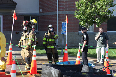 During a drill, crews respond to a simulated chemical spill at University Village Aug. 2011.