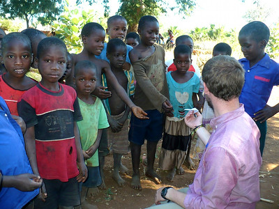 (Jacob Thompson) Entertaining the village kids with a paper airplane while their parents participated in our survey.
