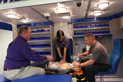Instructor teaches students in ambulance simulator