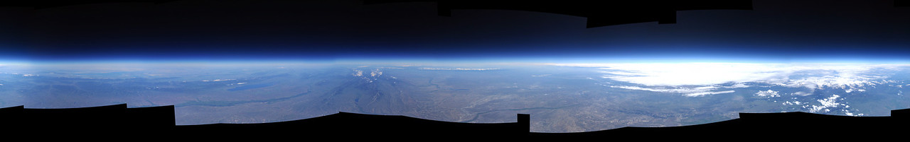 Taken in July 2013 at an altitude of approximately 90,000 feet above sea level, the rich blue line in this panorama is Earth's ozone layer; the light blue line is the vast majority of our atmosphere. The light blue line is where almost all of Earth's weather occurs. Commercial jet aircraft typically fly at about 35,000 feet, which is less than half the altitude that this picture was taken from by WSU student camera systems. The image was taken over Roosevelt, Utah.