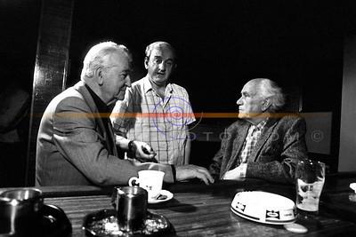 Bryan MacMahon, John B Keane and Eamon Kelly in deep conversation  betwen takes, during a filiming session in Listowel. Photo Brendan Landy