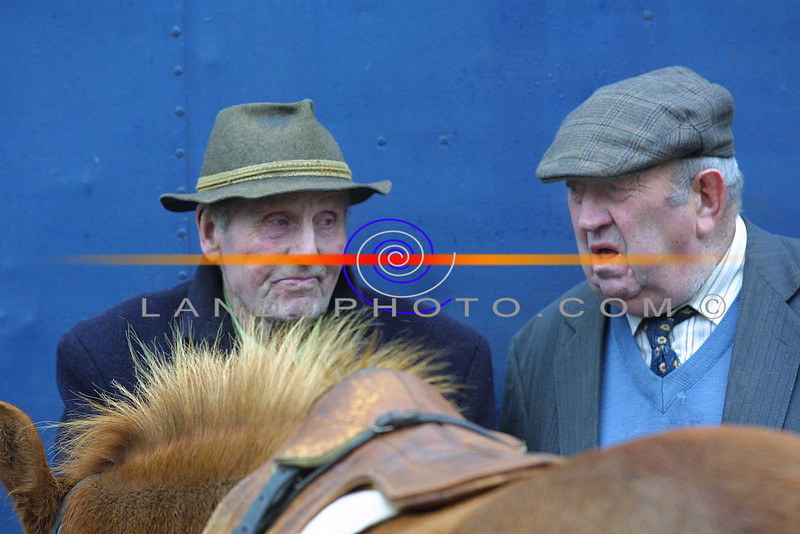 Two horse fair goers in deep conversation during the annual horse fair that is held in market st in Listowel after the Listowel races.<br /> Pic Brendan Landy