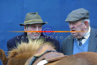 Two horse fair goers in deep conversation during the annual horse fair that is held in market st in Listowel after the Listowel races. Pic Brendan Landy