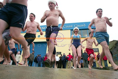 Swimmers head to te cold icy waters of the north atlantic in Ballybunion as they partake in the annual Ballybunion sea and cliff rescue  charity day swim. Photo Brendan Landy