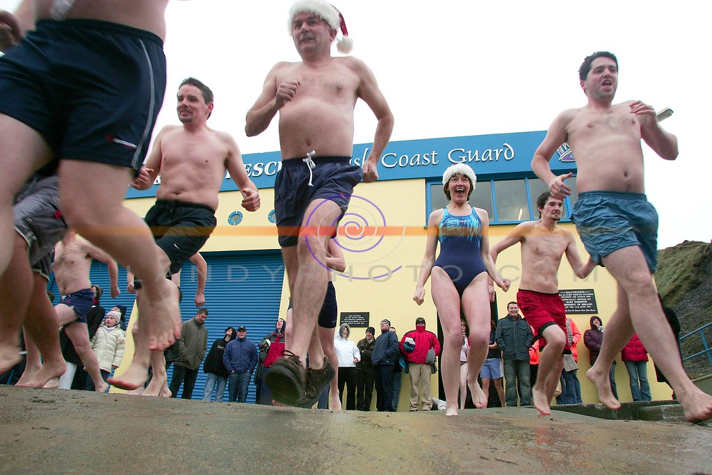 Swimmers head to te cold icy waters of the north atlantic in Ballybunion as they partake in the annual Ballybunion sea and cliff rescue  charity day swim.<br /> Photo Brendan Landy