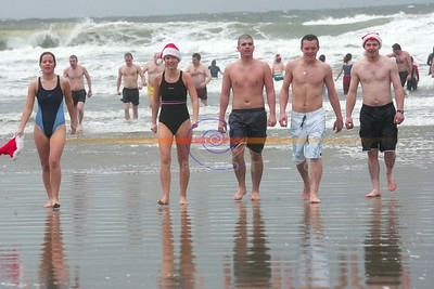 Swimmers emerge from the cold waters  after partaking  in the annual Ballybunion sea and Cliff Rescue  christmas Day Swim in Ballybunion. Photo Brendan Landy