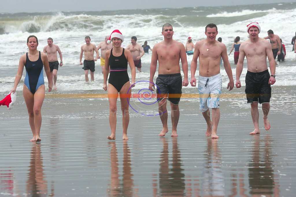 Swimmers emerge from the cold waters  after partaking  in the annual Ballybunion sea and Cliff Rescue  christmas Day Swim in Ballybunion.<br /> Photo Brendan Landy