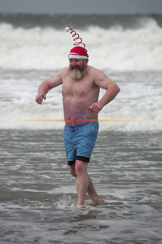 Micheal O Keeffe of Lixnaw braves the cold waters and driving hail to partake in the annual Ballybunion sea and Cliff Rescue  christmas Day Swim in Ballybunion.<br /> Photo Brendan Landy