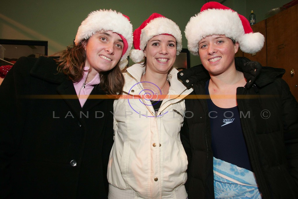 Cousins Orla Boyle, Eilish O Reilly and Aisling Boyle of Ballybunion keep warm before the off of the annula Christmas day Swim in Ballybunion.<br /> Photo Brendan Landy