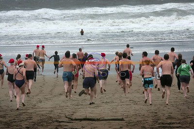 Ther're Off..... Swimmers sprint to teh cold atlantic waters in Ballybunion for the annual  Christmas day Swim. Photo Brendan Landy