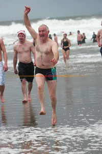 Mike Ryann of Ballybunion emerges from the water in great form after been the best fundraiser after collicting 1400 euro in the Ballybunion sea and cliff rescue Charity Christmas day swim. Photo Brendan Landy