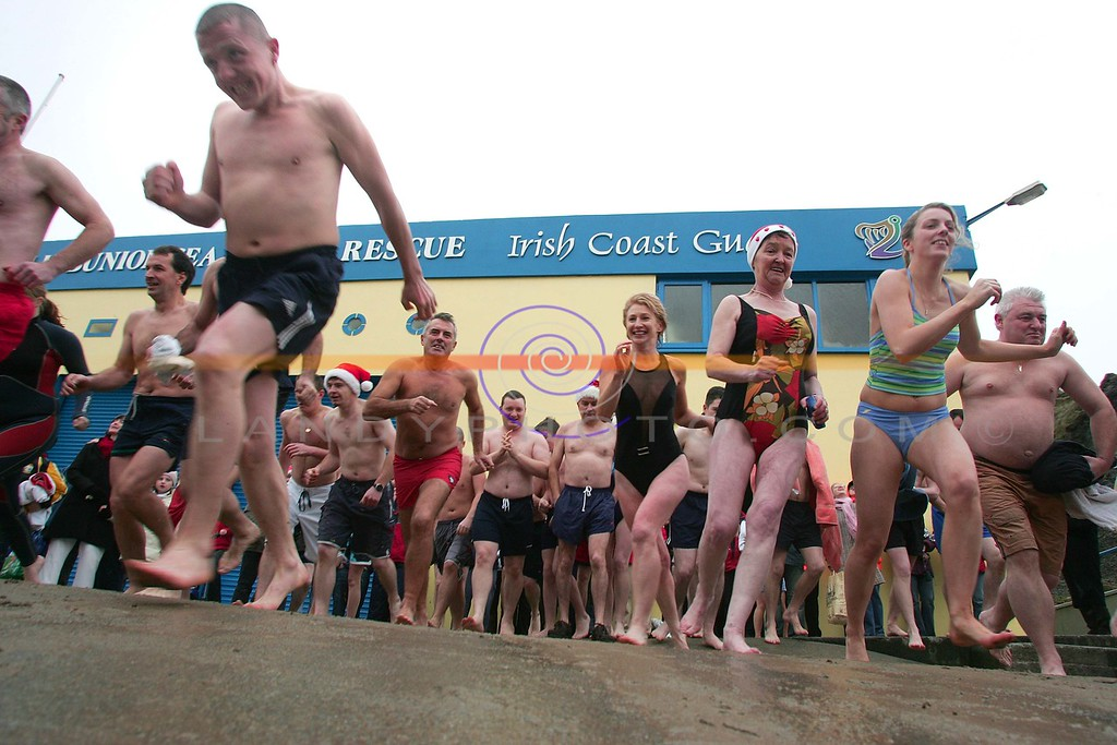 There're off  Swimmers make their way to the icy waters  in Ballybunion on the annual Christmas  day swim.<br /> Photo Brendan Landy