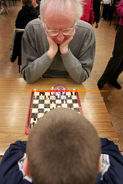 Listowel Solictor Hugh Joyce  teaches children from Listowel the paitence of chess at the Listowel Community Games Chess and Draughs finals in St Michaels College.<br /> Photo Brendan Landy