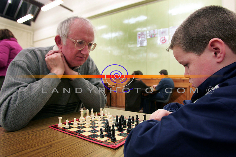 LIstowel Solictor Hugh Joyce teaches Listowel boy Shane O Sullivan the art of Chess at the Listowel Community Games finals.<br /> Photo Brendan Landy