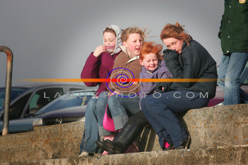 Huddled up trying to keep warm are these local punters at the Ballybheigue races on the  beach.<br /> Photo Brendan Landy