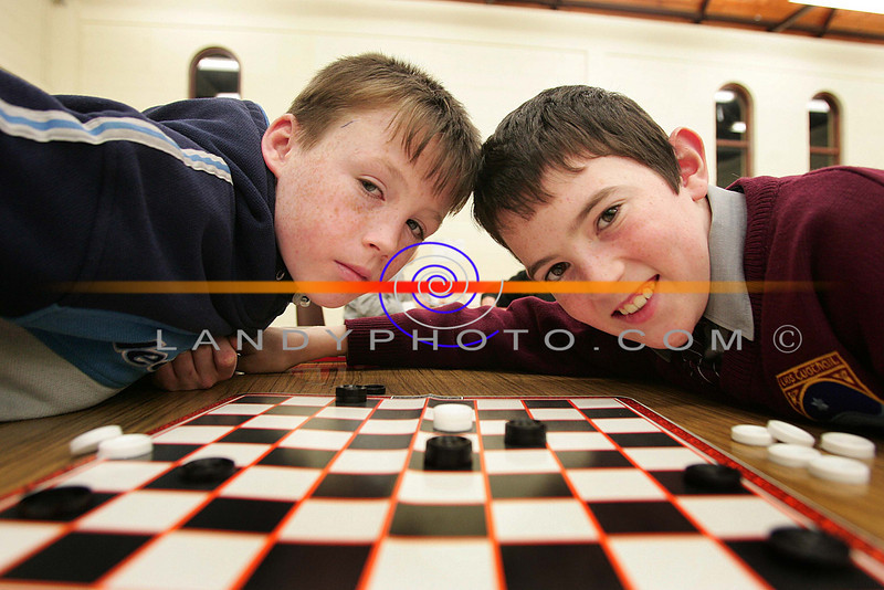 Eddie Joe Walsh and Daniel Collins put their heads togeather at the Listowel Community Games Chess and Draughs finals in Listowel.<br /> Photo Brendan Landy