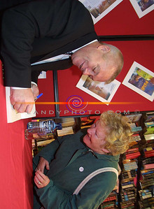 Joan Buckley of Listowel share a joke with Paidi as he signes his book for her ain Hannons bookshop in Listowel. Pic Brendan Landy