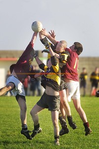 A Mangle of Duagh and Clounmacon bodies under a ball in the Junior Championship final in Ballybunion. Pic Brendan Landy
