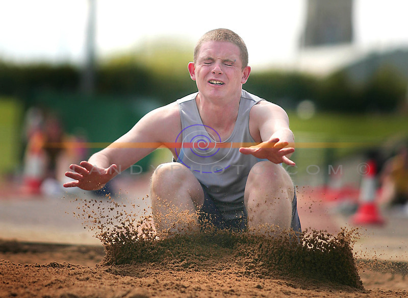 Shane Delaney from Causeway jumps into the sand  in the Long Jump at the County Athletic Championship.<br /> Photo Brendan Landy