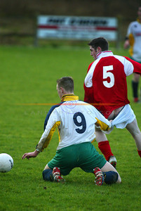 The Cheek of it... The cheek of Kerry District Leagues Ger Lovette as he stretchs a point with Limerick DL's  Shay Lyons  in the clash in Askeaton. Pic Brendan Landy